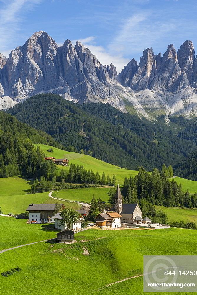 View of Church and mountain backdrop, Val di Funes, Bolzano Province, Trentino-Alto Adige/South Tyrol, Italian Dolomites, Italy, Europe