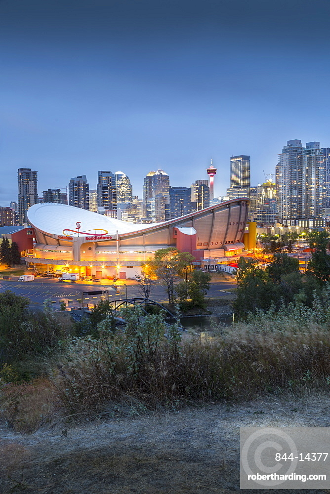 View of the Saddledome and Downtown skyline from Scottsman Hill at dusk, Calgary, Alberta, Canada, North America