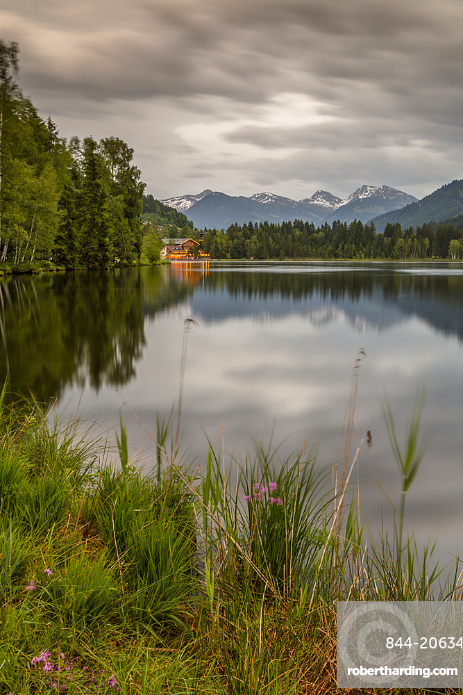 Lake side bar and mountainous backdrop at Schwarzsee near Kitzbuhel, Austria, Europe