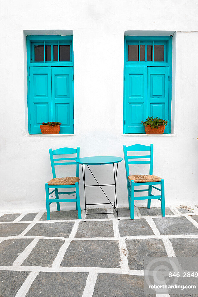 Typical Greek cafe table and chairs with shuttered windows, Pano Chora, Serifos, Cyclades, Aegean Sea, Greek Islands, Greece