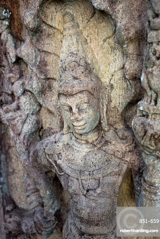 Carving of Buddha at the ancient city of Polonnaruwa, Sri Lanka