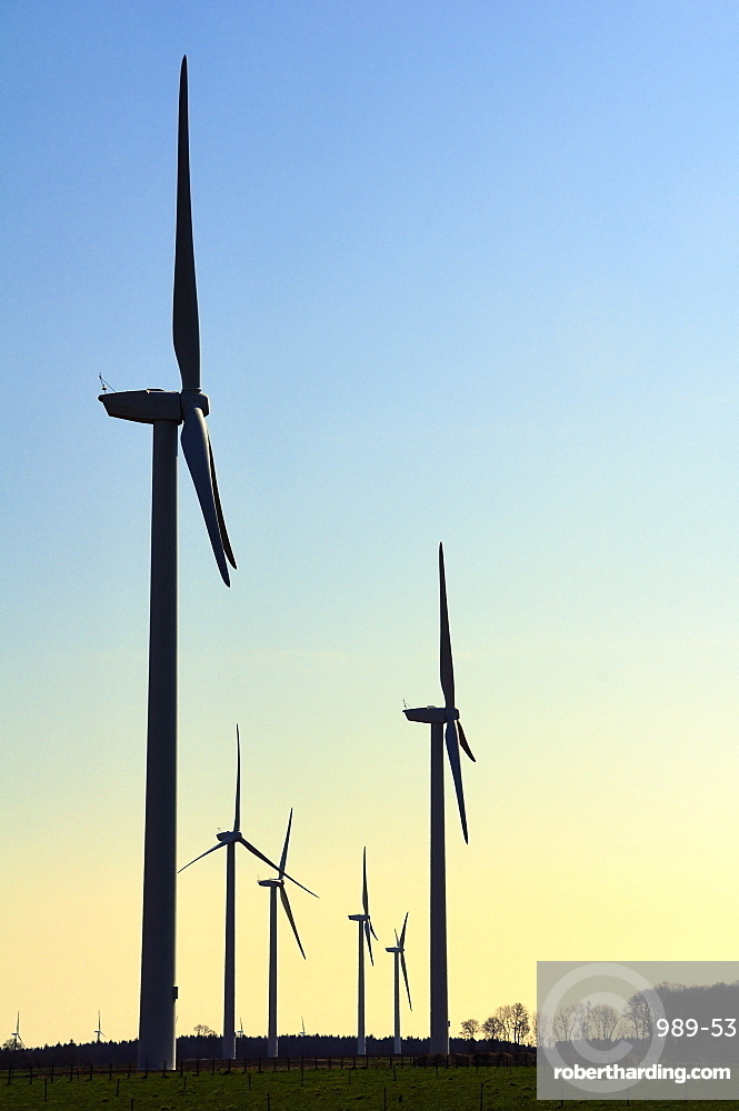 Wind farm silhouetted at dawn, Eaucourt-sur-Somme, Picardie, France.