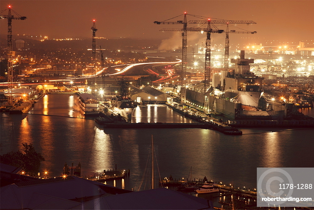 Cityscape with cranes at night, Norfolk, Virginia
