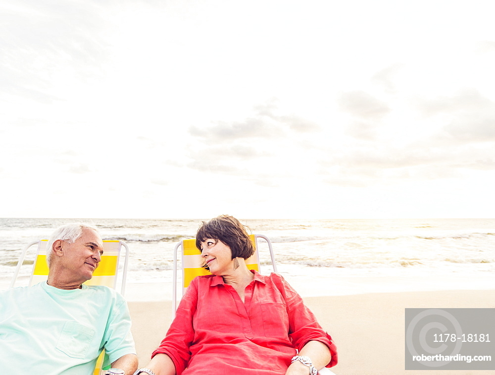 Older couple relaxing on beach, Jupiter, Florida
