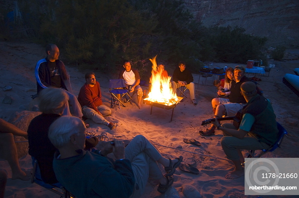 People relaxing around camp fire