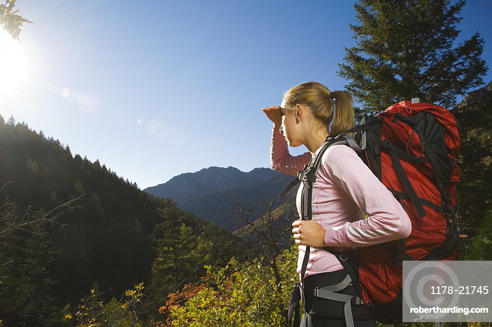 Female hiker shielding eyes with hand, Utah, United States