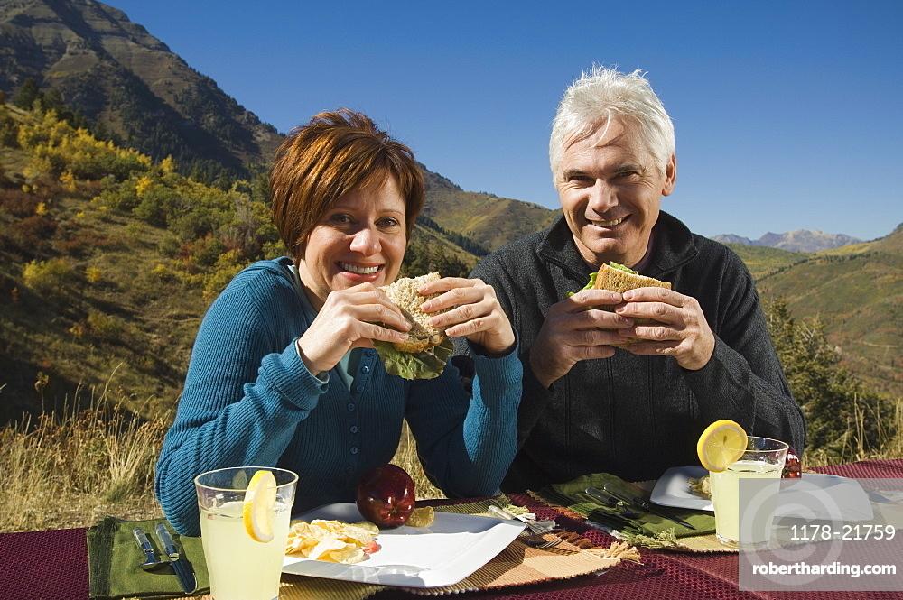 Senior couple eating outdoors, Utah, United States