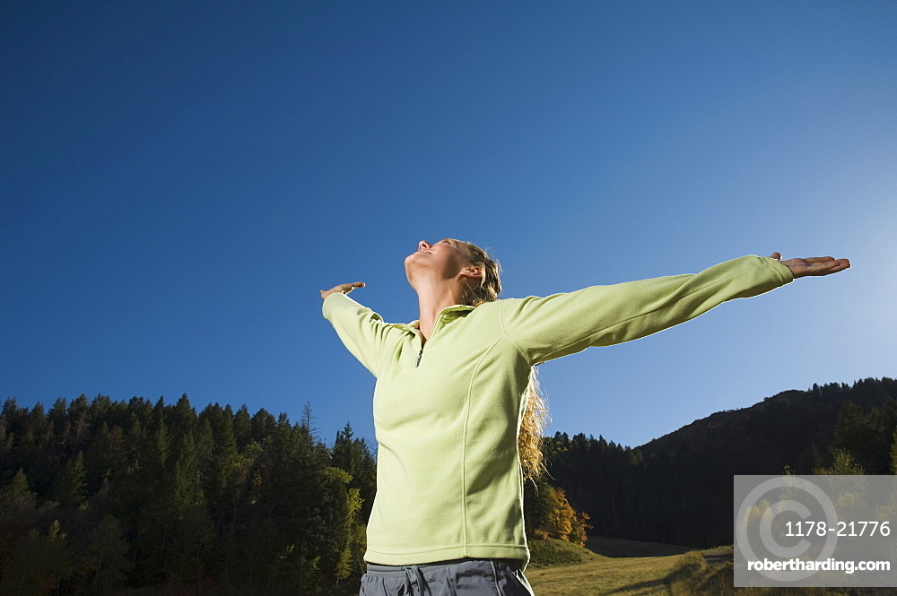 Woman with arms outstretched, Utah, United States