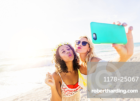 Female friends taking selfie on beach, USA, Florida, Jupiter