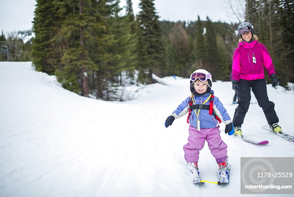 Little girl (2-3) learning skiing with mother, USA, Montana, Whitefish