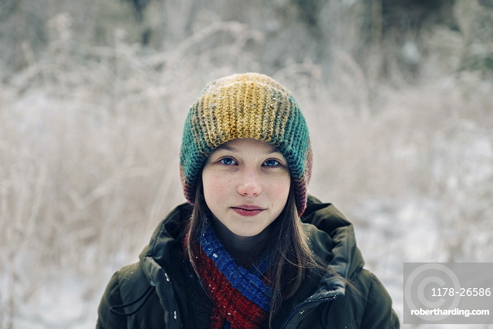 Teenage girl with colorful woollen hat during winter