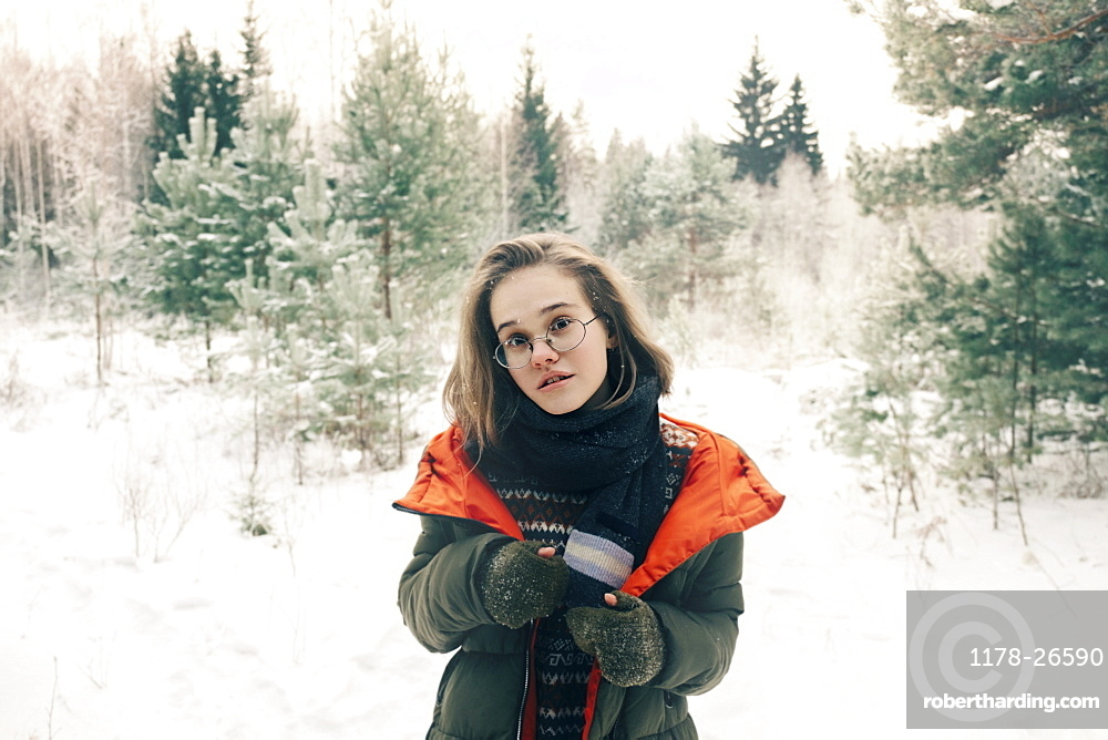 Teenage girl with glasses during winter