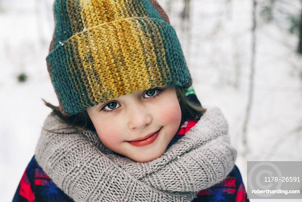 Girl in woollen hat during winter