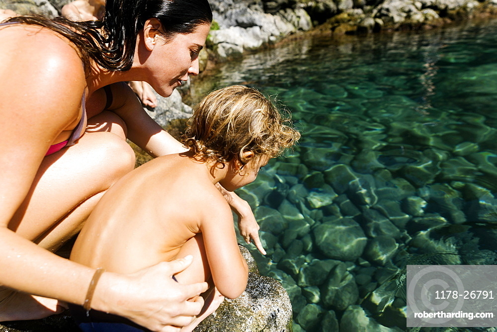 Woman with her son by tide pool