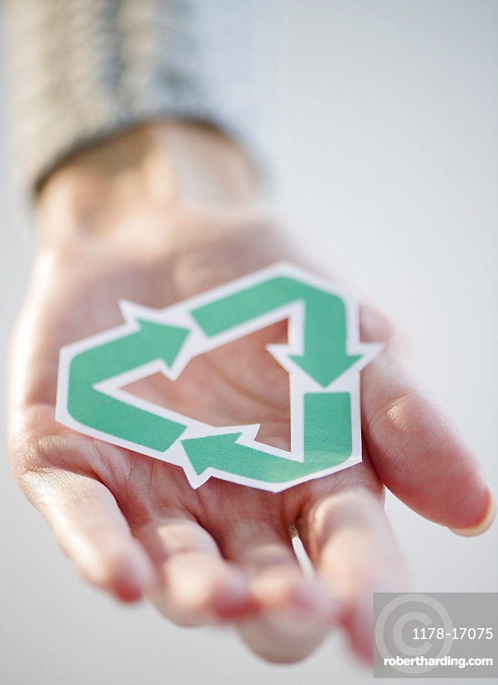 USA, New Jersey, Jersey City, Woman's hand holding recycling symbol