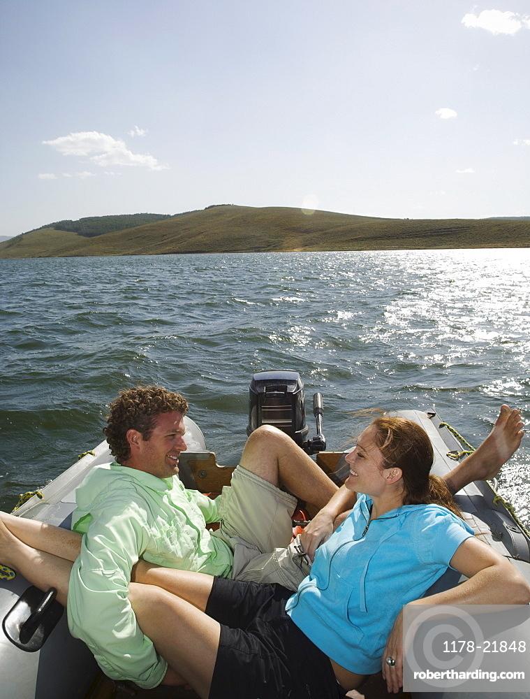 Couple on motorboat, Utah, United States