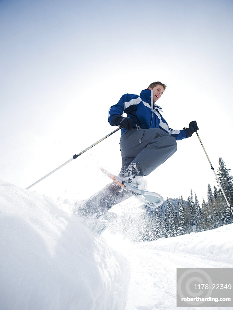A man snow shoeing