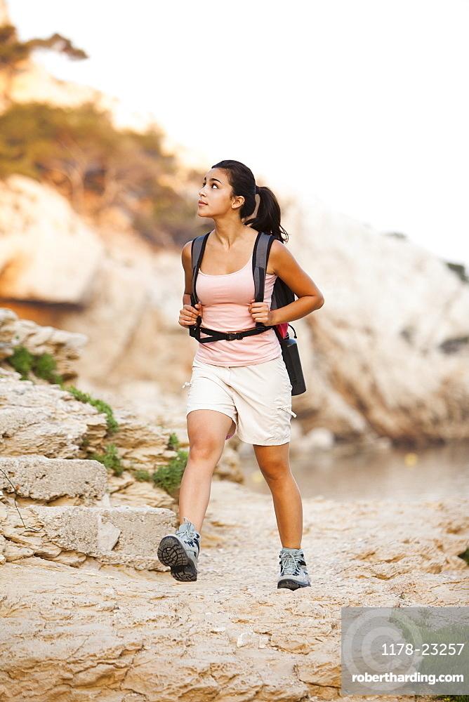 France, Marseille, Woman hiking in rocky terrain, France, Marseille