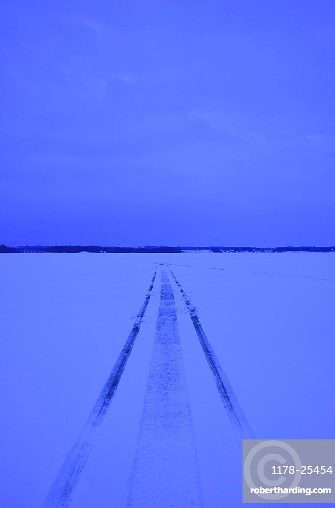 Snowmobile tracks on frozen lake, USA, New York State, Lake Champlain