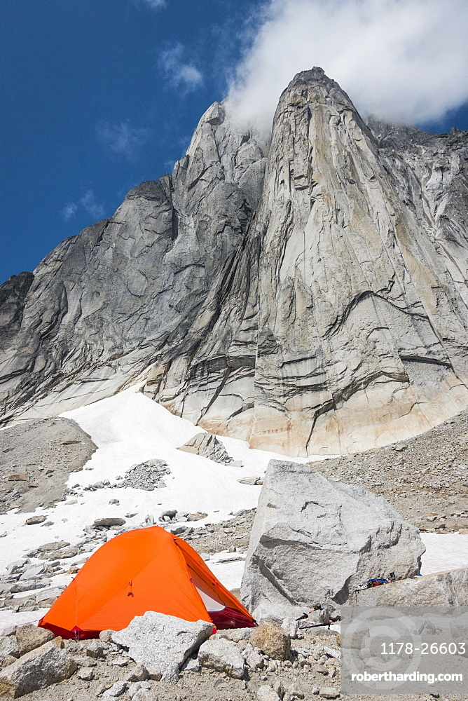 Orange tent in Purcell Mountains, Bugaboo Provincial Park, British Columbia, Canada