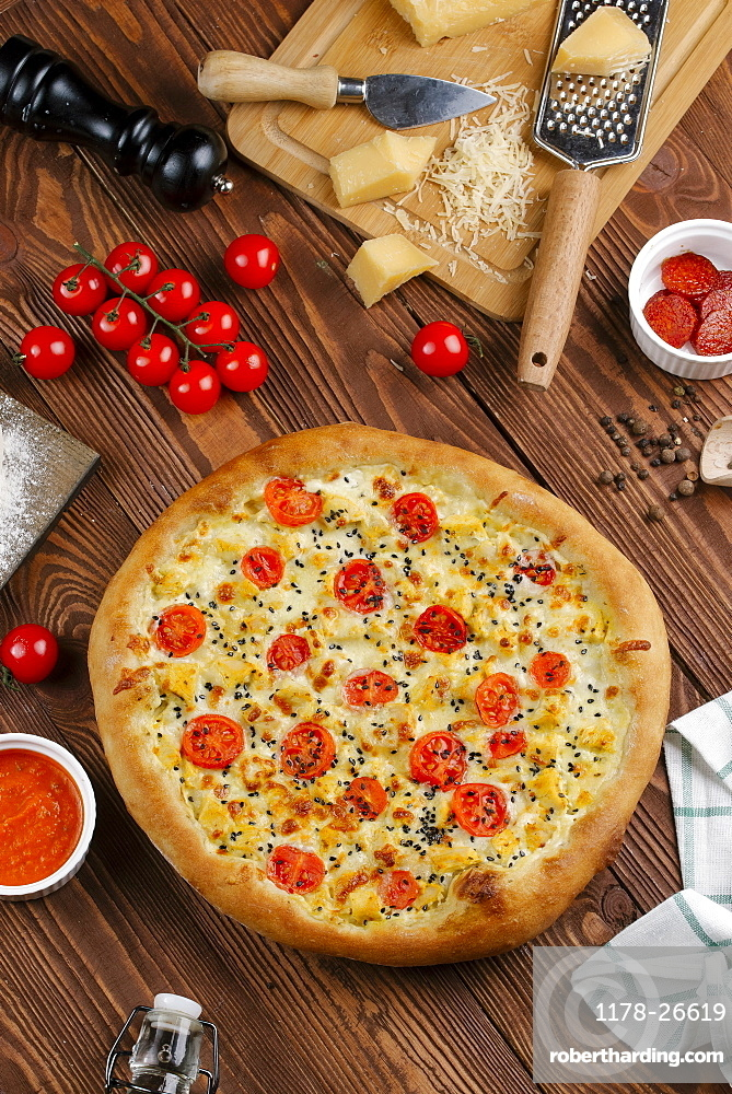 Tomato pizza with ingredients