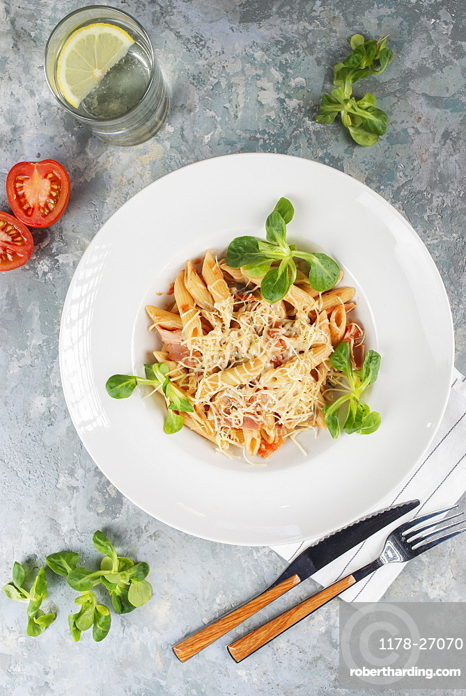Pasta topped with cheese and basil