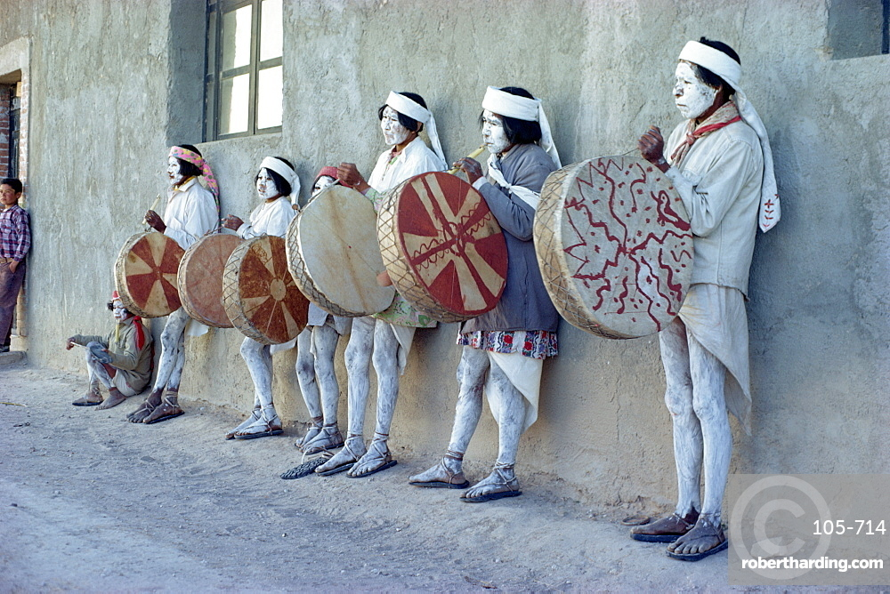 Tarahumaras Indians with full body decoration and ceremonial drums for Easter celebrations, Norogachi, Sierra Madre, Mexico, North America