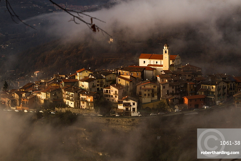 Village of La Bollene Vesubie in the evening mist in the Maritime alps.