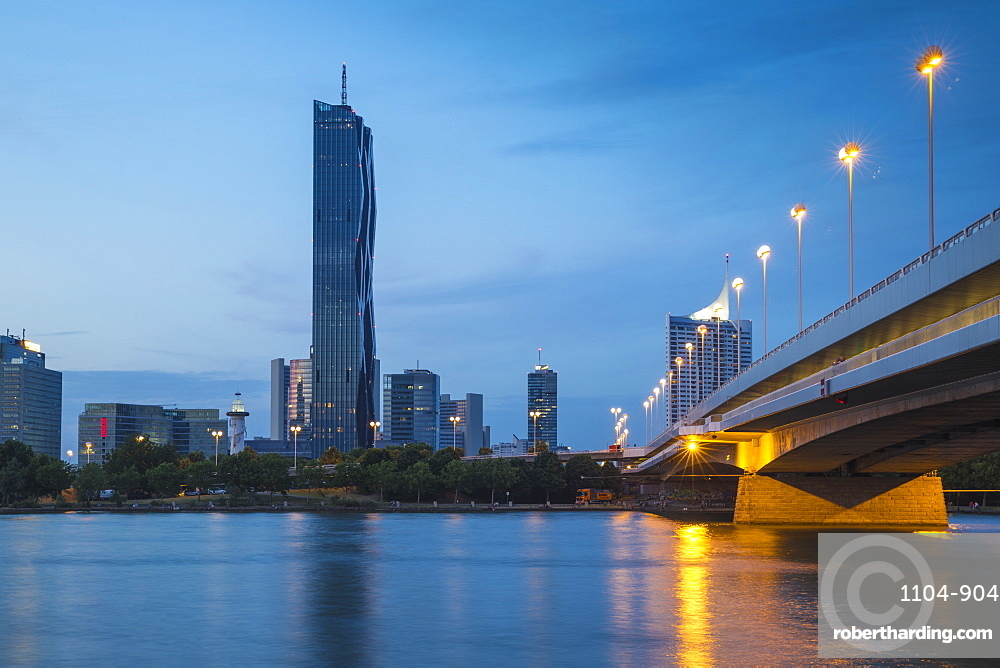 Austria, Vienna, Donau City and DC building reflecting in New Danube River