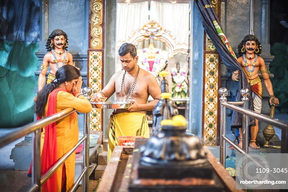 Hindus worshipping and praying at Batu Caves, Kuala Lumpur, Malaysia, Southeast Asia, Asia