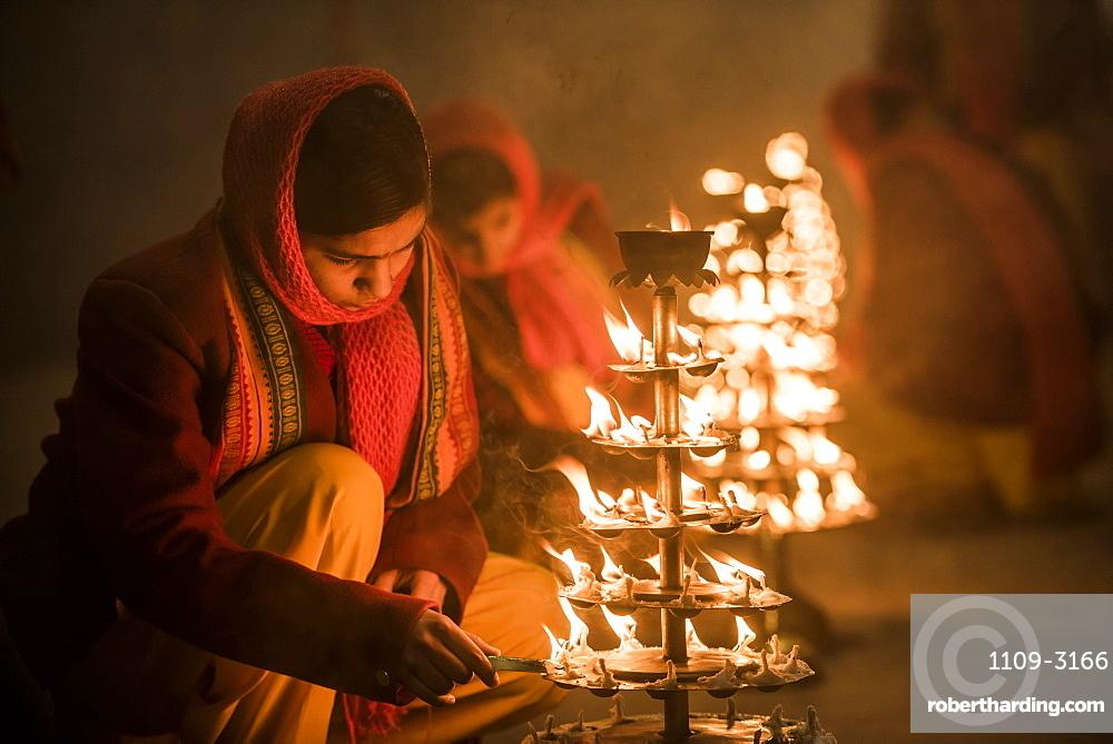 Ganga Aarti Hindu ceremony at Assi Ghat at dawn, Varanasi, Uttar Pradesh, India, Asia
