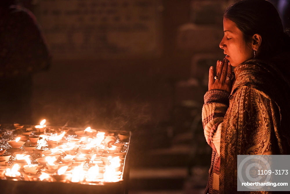 Praying at a Hindu temple in Varanasi, Uttar Pradesh, India, Asia