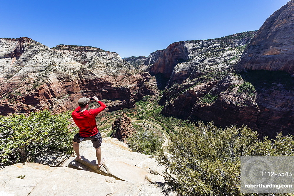 Photographer shooting the valley floor from Angel's Landing Trail in Zion National Park, Utah, United States of America, North America