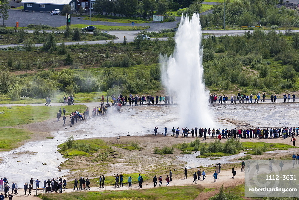 Tourists watch the eruption of the Strokkur geyser, Haukadalur valley, Hvita River, Iceland, Polar Regions