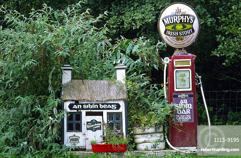 Old gas station, petrol station with Murphys beer sign on top near a pub in Lauragh on the Ring of Beara, County Kerry, Ireland, Europe