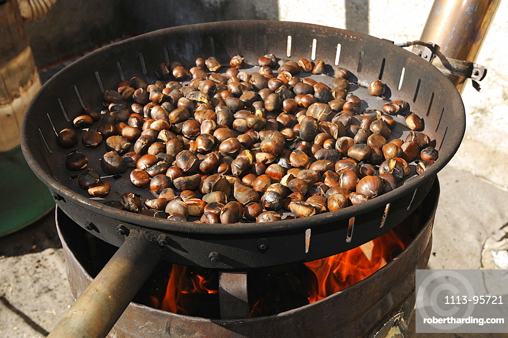 chestnuts roasting over a fire stock photo