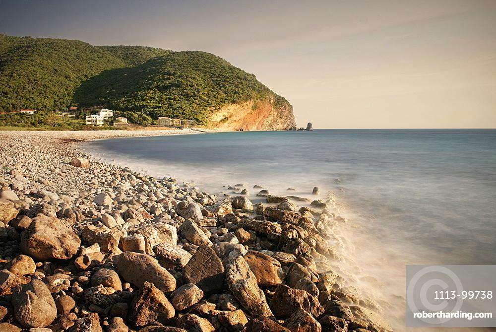 Surf on a rocky beach in Petrovac near Budva, Adriatic coastline, Montenegro, Western Balkan, Europe, long time exposure