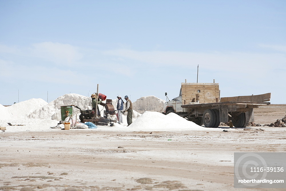People Packaging Salt From The Salar De Uyuni In The Village Of Colchani, Potosi Department, Bolivia