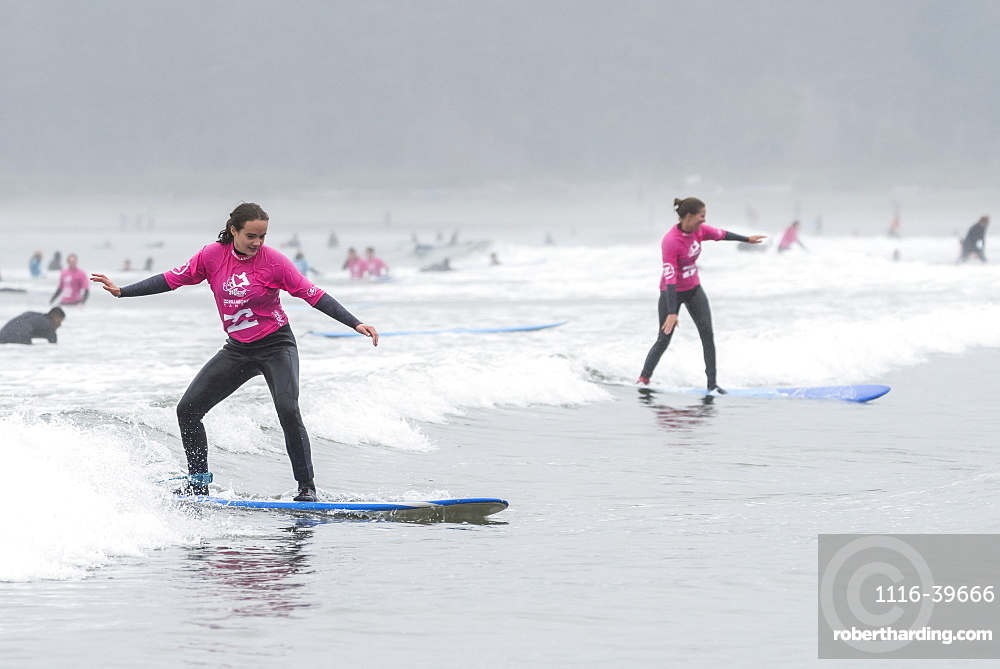 Girls learning to surf at Cox Bay Beach, Pacific Rim National Park, Vancouver Island, Tofino, British Columbia, Canada