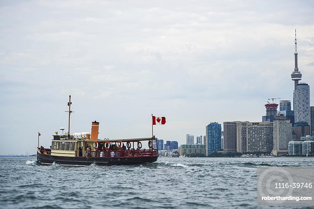 Royal Canadian Yacht Club (RCYC) launch heading to the Toronto island at dawn, Toronto, Ontario, Canada
