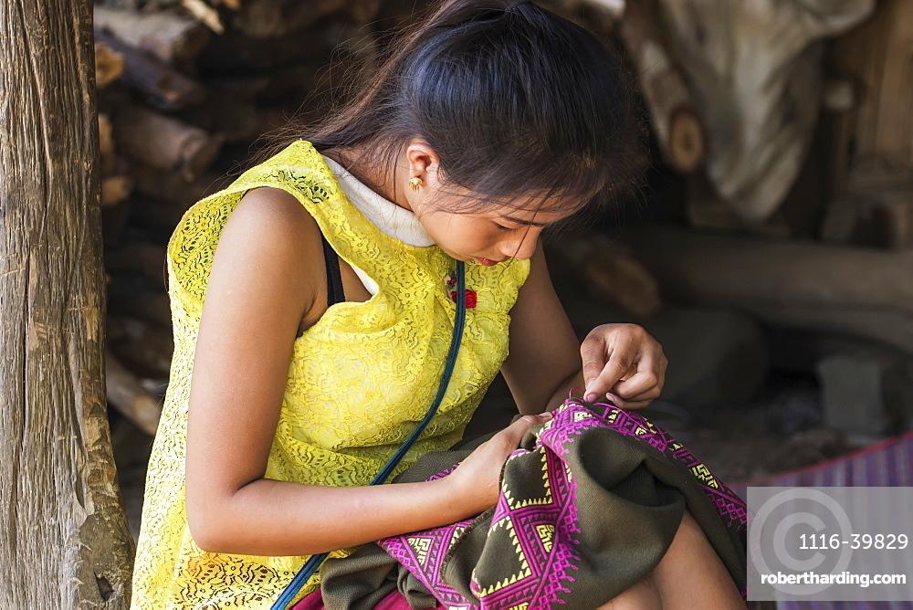 Hmong woman making embroideries, Na Aouan Village, Luang Prabang, Laos