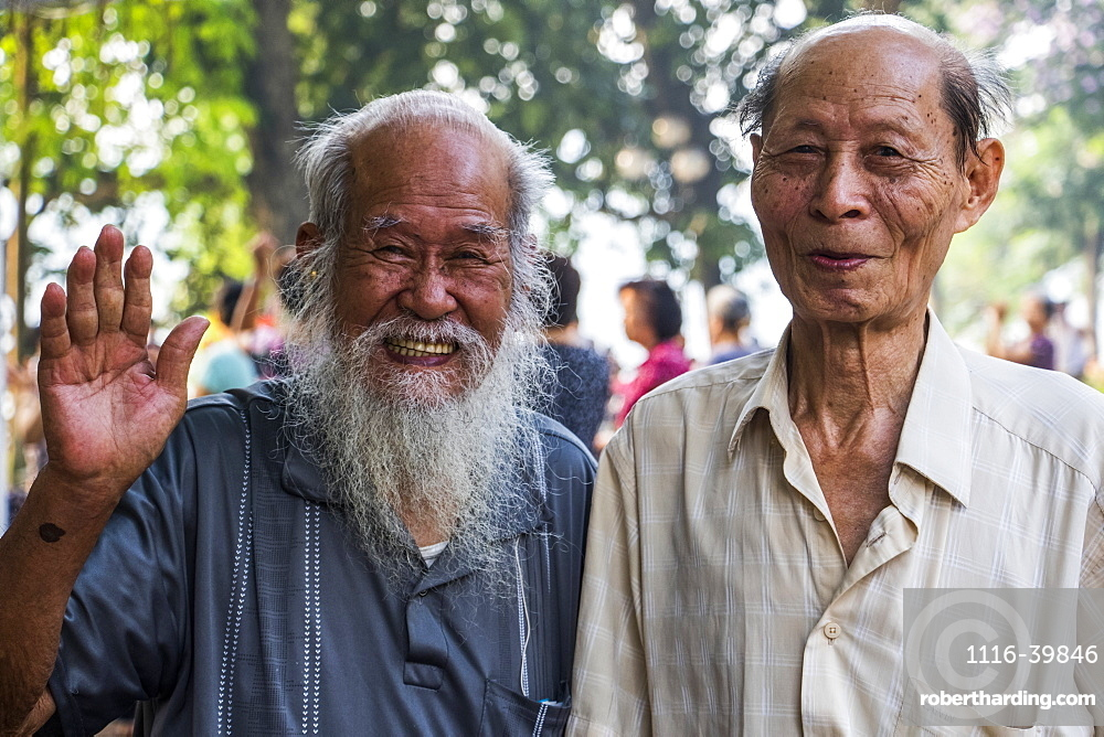 Pose of senior men smiling and waving for the camera, Hanoi, Hanoi, Vietnam