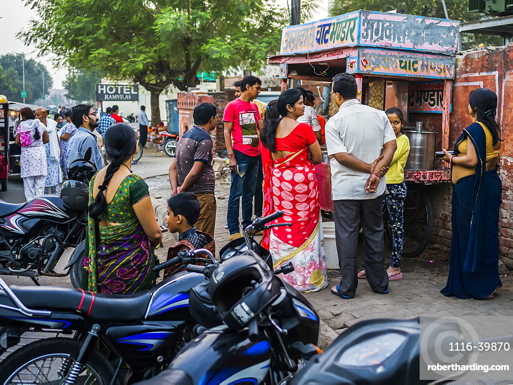 People lined up outside a vendor's stall to make a purchase, Jaipur, Rajasthan, India