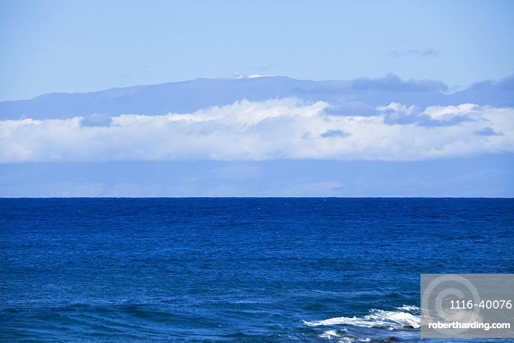 Mauna Kea with snow and observatories viewed from North Kohala coast, Island of Hawaii, Hawaii, United States of America