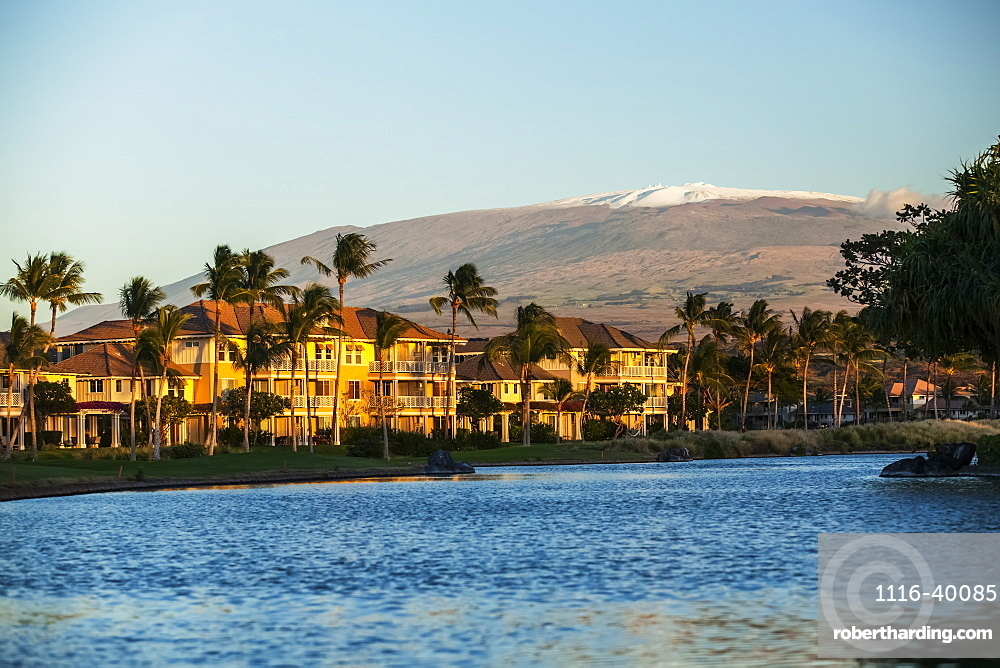 Condominiums and a view of the snow-capped Mauna Kea from the King's Shops at Waikoloa Resort, Island of Hawaii, Hawaii, United States of America