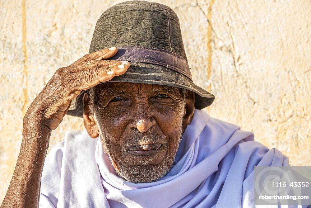 Portrait of an Eritrean man wearing a hat and looking into the camera, Monday livestock market, Keren, Anseba Region, Eritrea