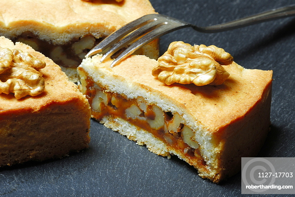 Engadine nut cake, short pastry with caramel and walnuts, fork