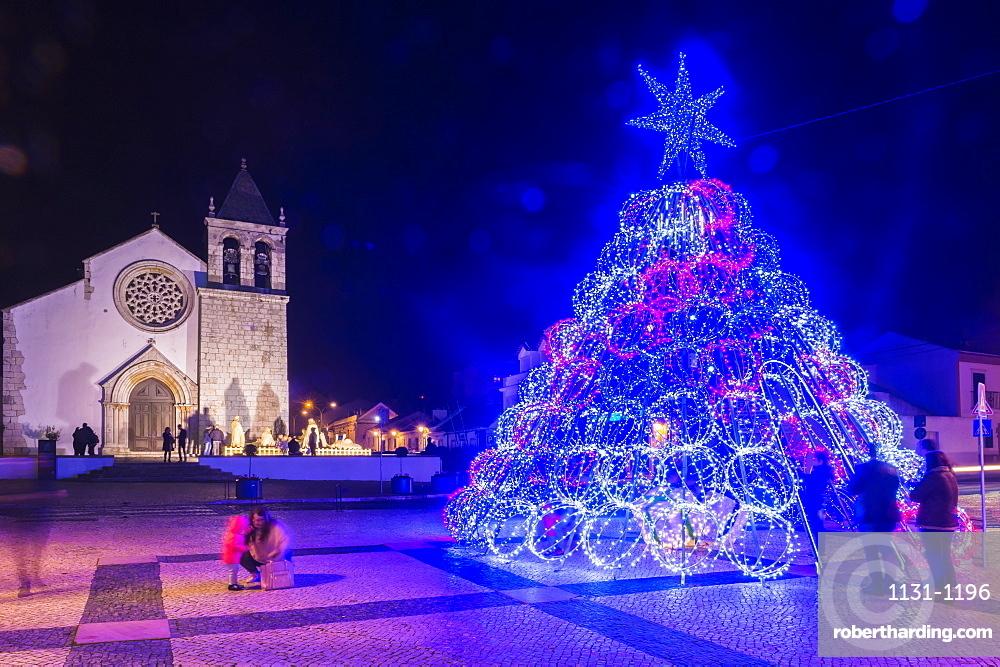 Illuminated modern Christmas tree in front of the Parish Church, Alcochete, Setubal Province, Portugal