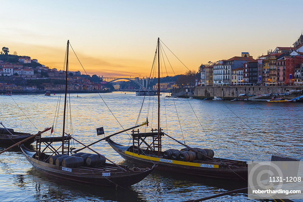 Sunset over Ribeira district and the Douro with Rabelos, Unesco World Heritage Site, OPorto, Portugal