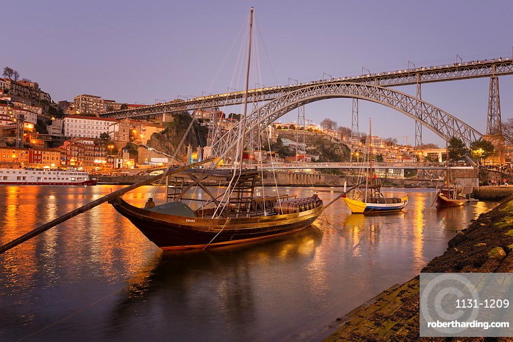 Sunset over Ribeira district, the Douro, Rabelos and Ponte Dom Luis I Bridge, Unesco World Heritage Site, OPorto, Portugal